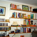 A wall of shelves transforms the space