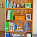 We recommended some organizing products and added decorative items to create a pretty, functional bookcase